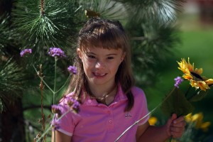 Young girl with developmental disabilities smiling for the camera