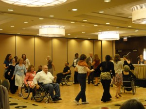 Conference Participants engaging in inclusive dancing as a conference optional physical activity break